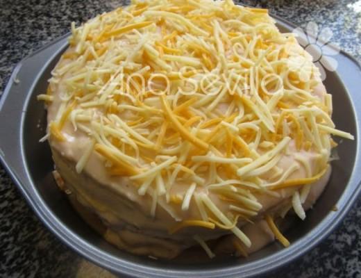 Espolvorear un poco de queso rallado